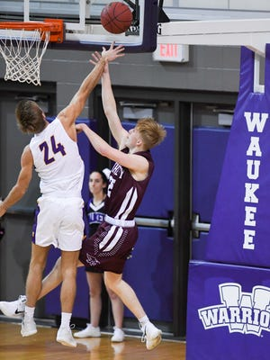 Ankeny's Dillon Carlson (25) gets his shot blocked by Waukee's Jaxx Rittman (24) during a basketball game between Waukee Warriors and the Ankeny Hawks on Friday, Jan. 5, 2018, at Waukee High School.