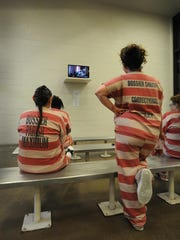 Inmates watch television at the Bossier Maximum Security Facility female detention section Pod A.