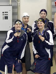 Owego Free Academy swimmers Katie Shoen, Jennifer Scott, Emma French and Summer Pierce pose with their medals after they finished eighth among public schools in the 200-yard freestyle Saturday at the New York State Girls Swimming and Diving Championships at Ithaca College.