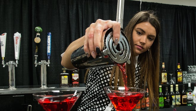 Christina Dogaru, assistant beverage manager at the Wicomico Youth and Civic Center pours a Cosmopolitan on Monday, Aug. 7, 2017.