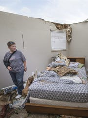 Lisa Skidmore surveys damage to the house where her
