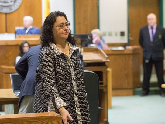 Francesca Estevez, sixth judicial district attorney, leaves the courtroom at the Third Judicial District Court, after a hearing Friday, November 17, 2017. Estevez has been accused of reckless driving and using her public office to attempt to evade investigation.