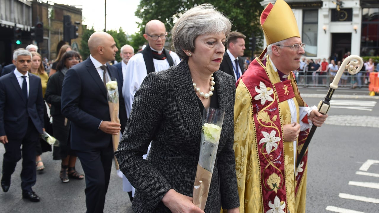 British Prime Minister Theresa May joined survivors, victims' families and emergency workers at a memorial service Sunday to mark a year since a deadly vehicle-and-knife attack brought terror to London Bridge on a warm Saturday night.