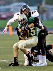 Brighton's Lee Conquest tackles Howell's Nick Swartz.