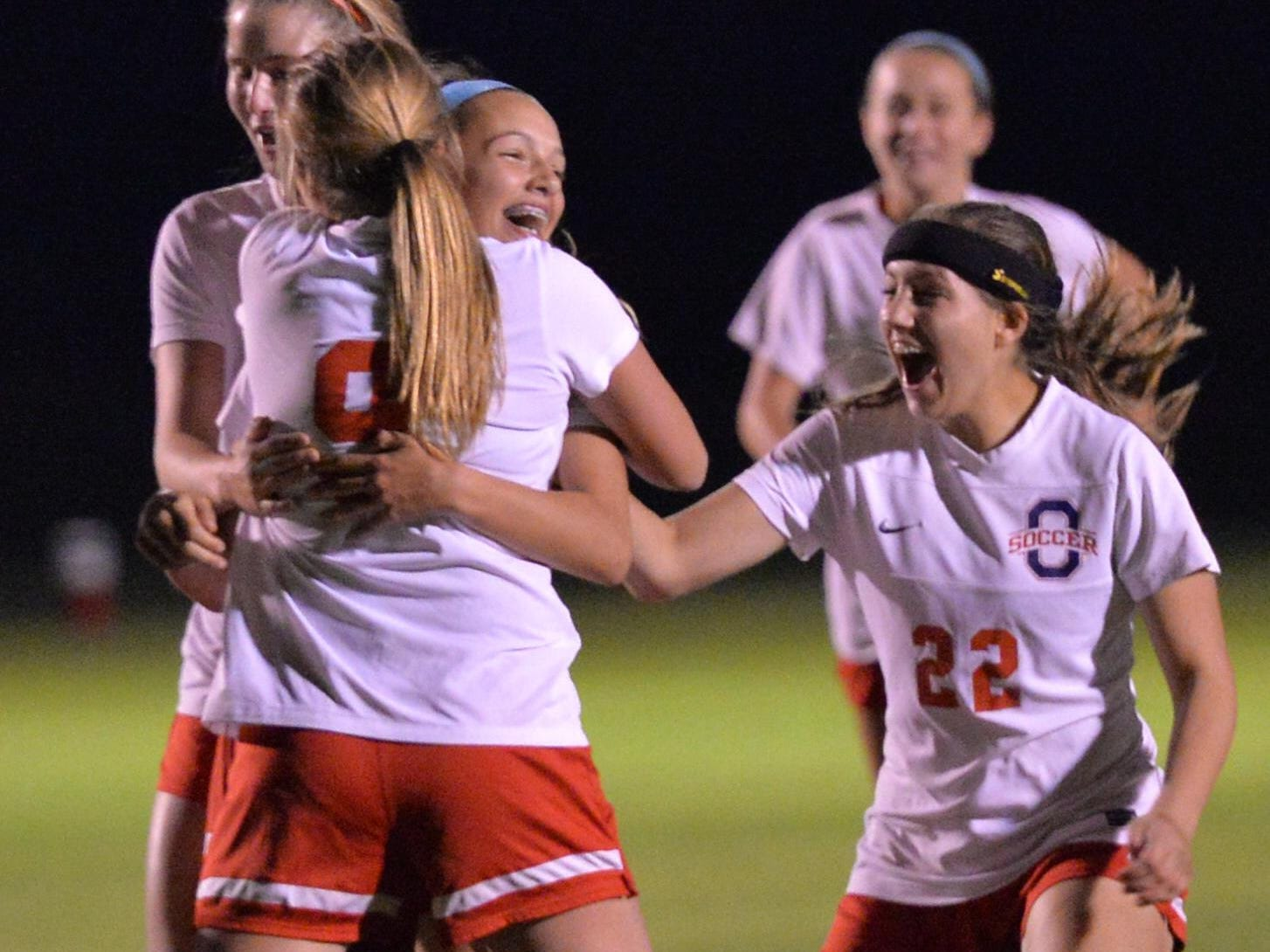 Oakland celebrates a score in the District 7-AAA championship. Oakland defeated Shelbyville 1-0 behind Abbey Peach's goal on Tuesday.