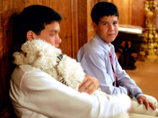 Brothers Joey, left, and Anthony DePasquale, of Lower Windsor Township, visited the governor's office to present a petition condemning puppy mills to Gov. Tom Corbett in person. Their adopted rescue dog, Franklin,came along.