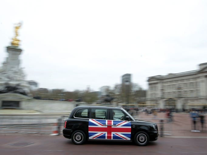 The new electric TX eCity taxi is driven near Buckingham