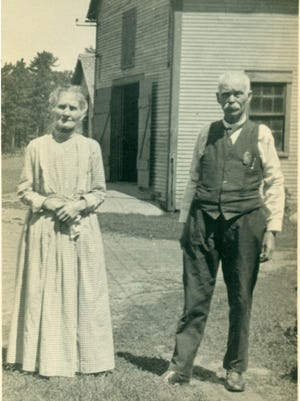 A 1924 photo of Bridget McGrath Reeves with her husband, Sheriff Reeves, at 138 Colchester Ave. in Burlington.