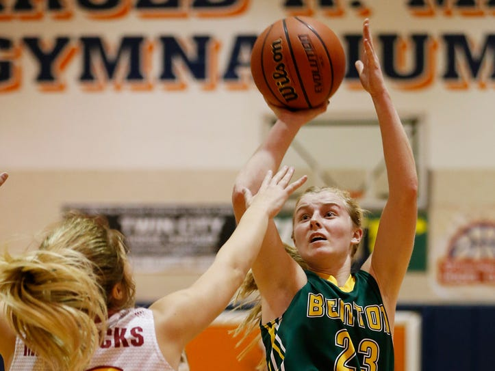Emma Fisher of Benton Central drains a shot in front