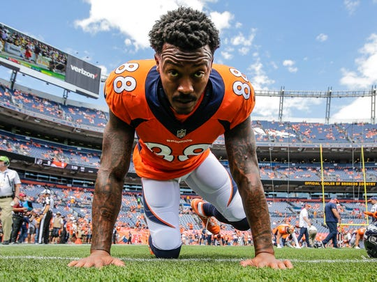FILE - In this Sunday, Sept. 16, 2018, file photo, Denver Broncos wide receiver Demaryius Thomas (88) stretches prior to an NFL football game against the Oakland Raiders in Denver. Thomas doesn't have the same rhythm with quarterback Case Keenum as Emmanuel Sanders does. Thomas and Keenum are the Denver Broncos' two highest-paid players on the team but Thomas has caught just 11 of the 21 passes thrown to him so far. (AP Photo/Jack Dempsey, File)