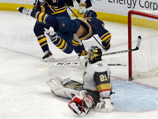 Buffalo Sabres right wing Justin Bailey (95) flips over Vegas Golden Knights goalie Marc-Andre Fleury (29) after scoring a goal during the third period of an NHL hockey game, Saturday, March 10, 2018 in Buffalo, N.Y. The Golden Knights won 2-1 in a shootout. (AP Photo/Adrian Kraus)