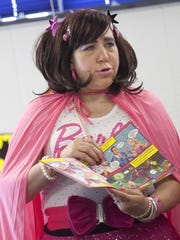 """Tricia Course-Cislo reads from the new book """"Princess Power"""" at the St. Clair County Library."""
