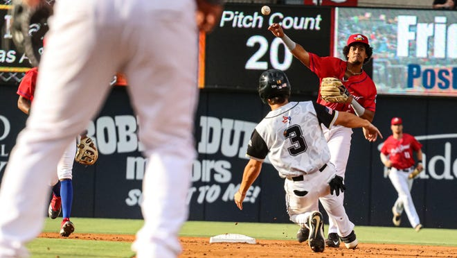 Amarillo Sod Squad shortstop Jose Torres turns a double play as Texarkana's Austin Colon slides into second base during Tuesday's game at Hodgetown. Torres had the game-winning base hit in the bottom of the ninth as the Sod Squad won 5-4.