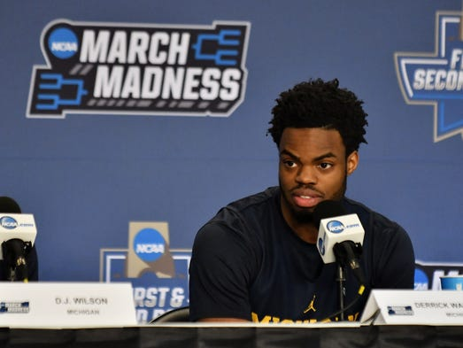 Michigan guard Derrick Walton Jr. (10) answers questions