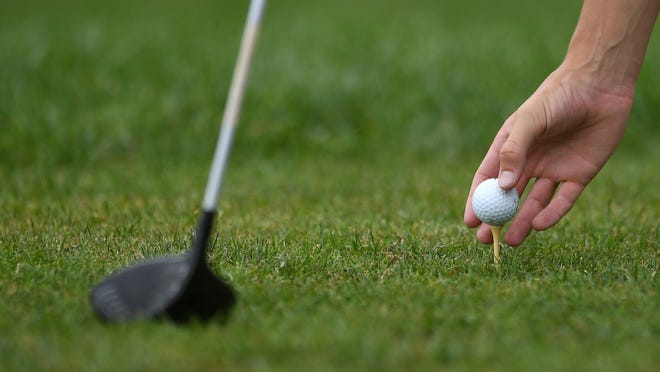 A golfer tees his golf ball on the third tee at Beechwood Golf Club in Fairview Township.