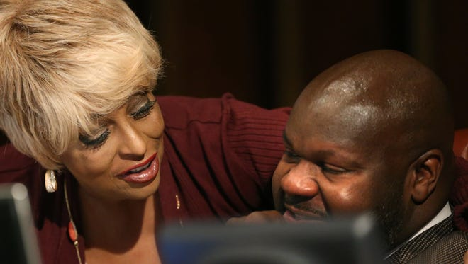 Memphis City Council vice chairwoman Janis  Fullilove puts a comforting arm around chairman Berlin Boyd as Boyd is emotionally moved by Morgan Symone Grant during the city council meeting Tuesday.