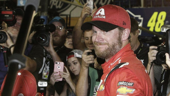 Dale Earnhardt Jr. is surrounded upon getting out of his car after a NASCAR Cup Series race at Homestead-Miami Speedway in Homestead, Florida on Nov. 19, 2017.