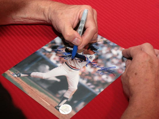 Former Atlanta Braves baseball player Dale Murphy signs