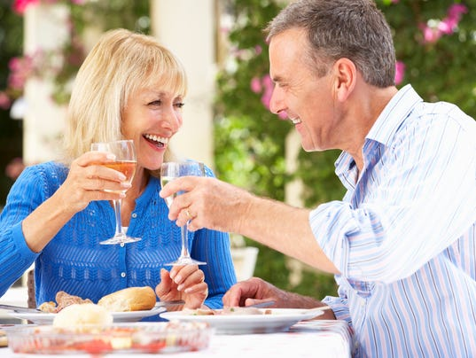 Couple Enjoying Meal outdoors