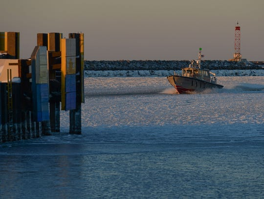A pilot boat cruises through the Delaware Bay keeping