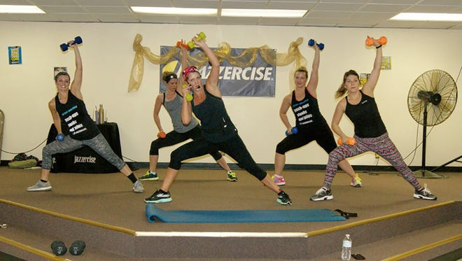 Jennifer Ivey (center) officially retired from Jazzercise after 28 years as an instructor - 20 years teaching at the Fairview Recreation Center.