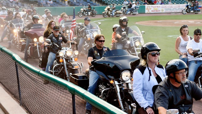 Bikers rev their engines for 21 seconds during a parade in PeoplesBank Park before an Atlantic League baseball game against the Lancaster Barnstormers Saturday, Aug. 26, 2017, in York. The Revolution hosted a Bike Night event in conjunction with 1st Capital Harley Davidson to raise funds to purchase a third motorcycle for the York City Police Motor Unit.