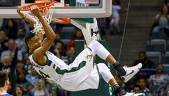 Giannis Antetokounmpo dunks against the 76ers during