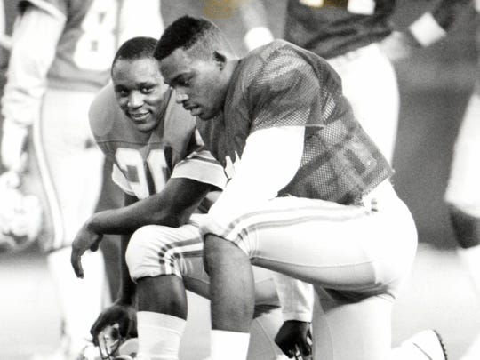 Andre Ware, right, and Barry Sanders.