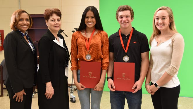 (From left) Tina Morris, assistant principal, Vineland High School; Carole Dallago, advisor, National Honor Society, Vineland High School; Stephany Romero, senior and member, National Honor Society, Vineland High School; Jared DeWinne, junior and member, National Honor Society, Vineland High School; and Billie Mattioli, president, National Honor Society, Vineland High School, are pictured at the high school on April 12 as Romero and DeWinne were honored for their service to the school and the community.