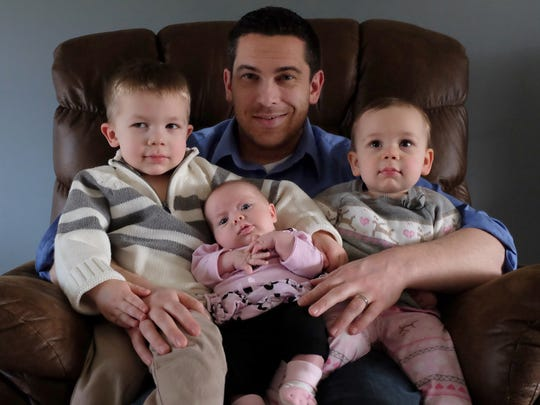 Mark Hamlin has his hands full with his three children,