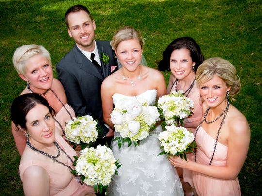 Chadwick Moore, wearing a suit, was a bridesmaid for his friend Kat Durst (center) at her 2010 wedding. The two met as students at the University of Iowa in Iowa City.