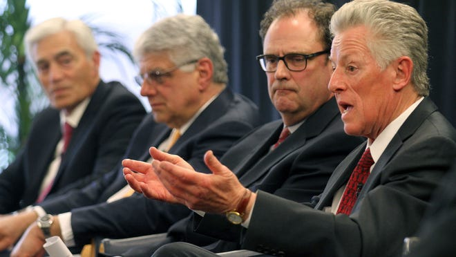 Former Gov. Jim Florio (right) speaks about Obamacare at a Monmouth University panel. Also shown are (left to right): John Lloyd, president and CEO of Meridian Health; Frank Vozos, president and CEO of Monmouth Medical Center; and Wardell Sanders, president of the New Jersey Association of Health Plans.