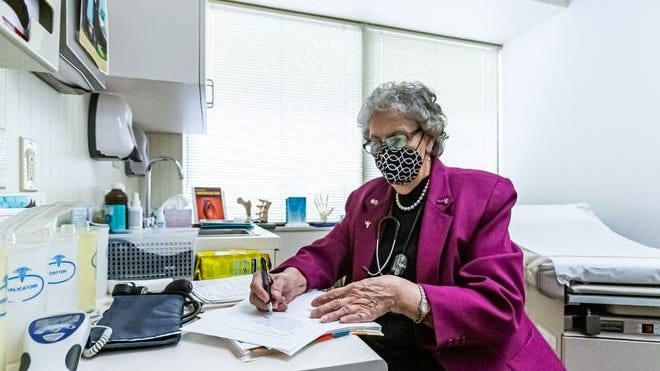 Barbara Hummel fills out paperwork at her office in Greenfield, WI. on Friday, Oct. 30, 2020. She has been serving patients in the Milwaukee area since 1995, however her practice has seen a dramatic decline in business due to the COVID-19 pandemic.