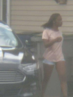 Milwaukee police released this photo of a woman suspected of acting as a lookout during a recent burglary.
