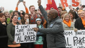 TODAY Show meteorologist Al Roker cheers with fans Tuesday outside Discovery Park of America in Union City.