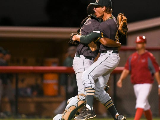Nick Durgin and Kevin Espiritusanto celebrate the Hustlers district baseball title Friday at Satellite High School.