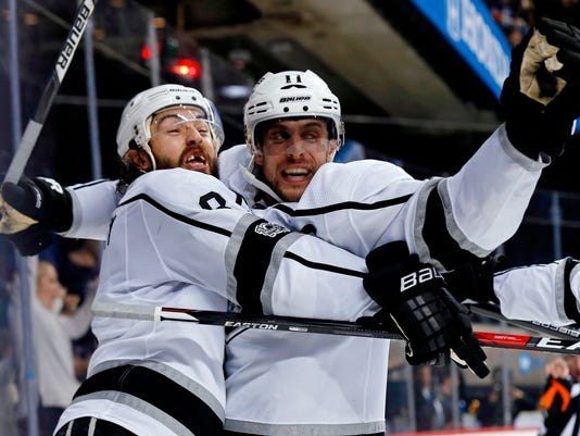 FILE - in this Dec. 16, 2017, file photo, Los Angeles Kings center Anze Kopitar (11) celebrates his goal with defenseman Drew Doughty during the third period of an NHL hockey game against the New York Islanders in New York. Kopitar could reach 1,000 games with the Kings if he stays healthy through the 2018-19 season. (AP Photo/Adam Hunger, File)