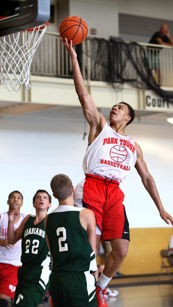 Park Tudor's Bryce Moore goes in for a layup against Pendleton Heights at the high school recruiting event held at Warren Central High School on Saturday, June 21, 2014.
