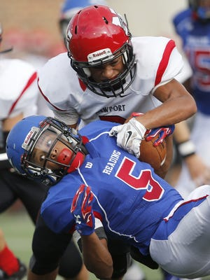 Newport defensive back Tyler Porter (2) tackles Reading running back Neriah Brooks (5), during the first half, Thursday, Aug. 27, 2015, at Sheakley Athletic Complex at the University of Cincinnati in Cincinnati, Ohio.