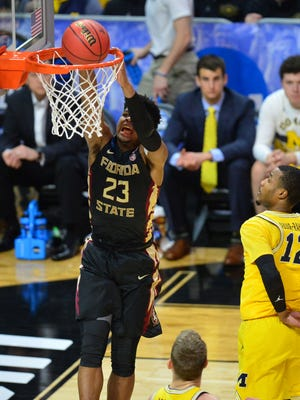 Florida State Seminoles guard M.J. Walker (23) scores a basket against Michigan Wolverines guard Muhammad-Ali Abdur-Rahkman (12) during the first half in the championship game of the West regional of the 2018 NCAA Tournament at STAPLES Center. Mandatory Credit: Gary A. Vasquez-USA TODAY Sports