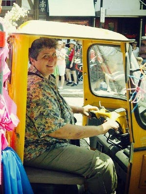 Maureen drove her motorized cart in the Northside 4th of July parade one year as the parade's grand marshal.