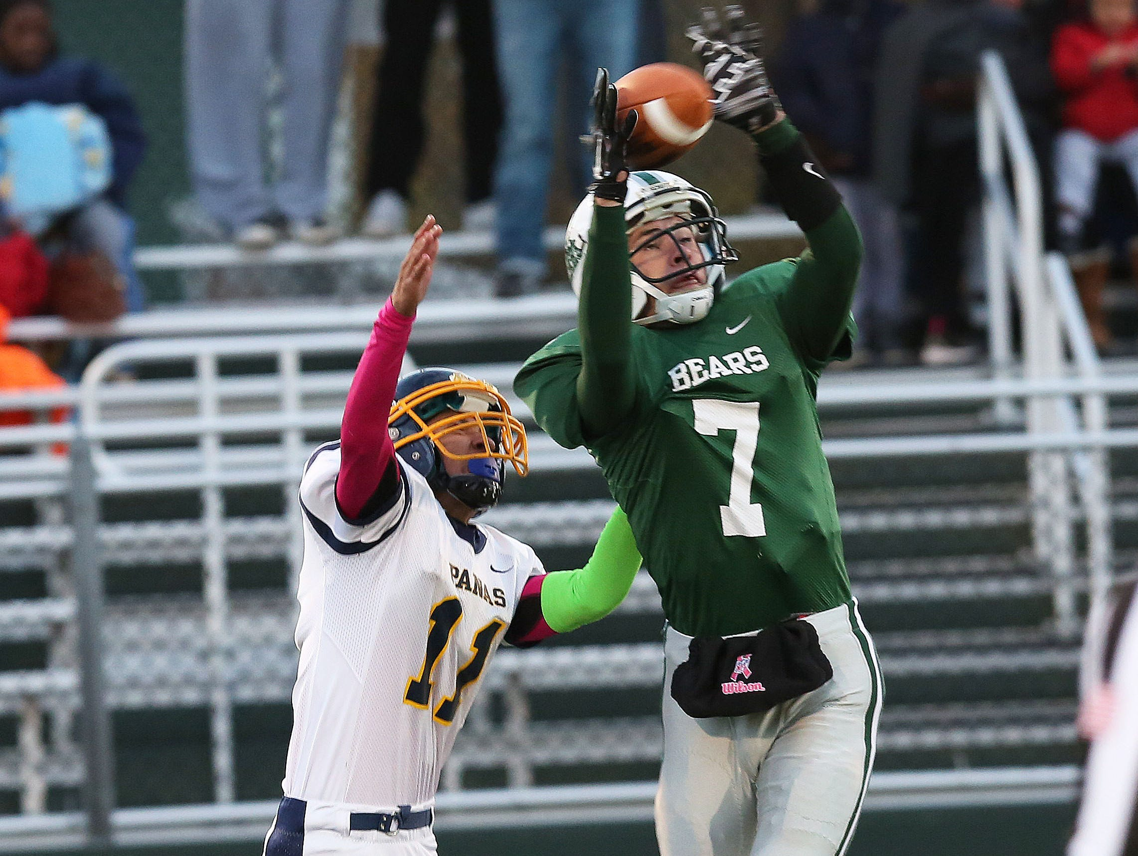 From right, Brewster's Matthew Catalano (7) breaks up a pass intended for Panas's Eric Otero (11) during football action at Brewster High School Oct. 17, 2015.