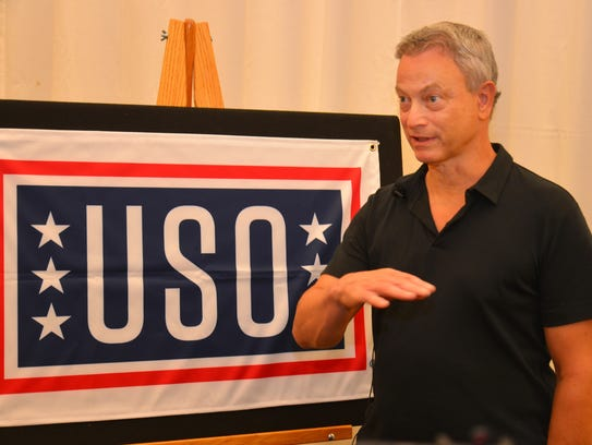 Gary Sinise talked to the media before performing with