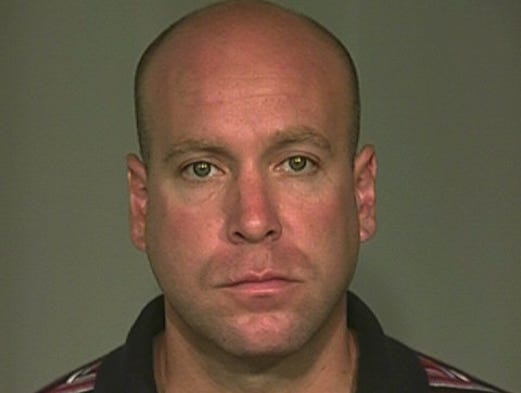 Indianapolis police officer David Bisard was found guilty Nov. 5, 2013, of all nine felony charges he faced in a 2010 vehicle accident that killed one motorcyclist and severely injured two others. This is his jail booking mugshot.