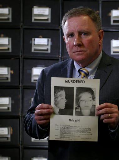 Former D&C reporter Jim Redmond stands with a flyer of the murdered Jane Doe.