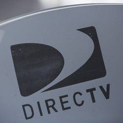 A DirecTV sattelite dish sits on a roof in New York City.