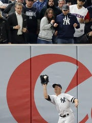 Brett Gardner makes a catch in deep left field to end
