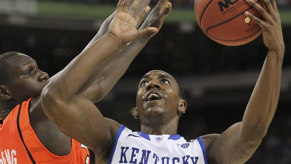 Marquis Teague drives against Gorgui Dieng in the second half. March 31, 2012