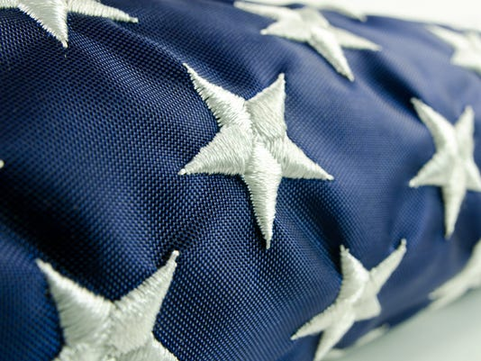 Close-up of stars on a folded American flag