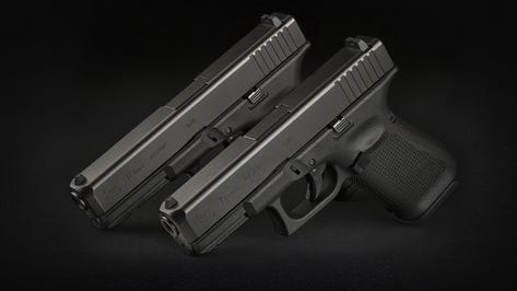 Two Glock 19's against a black background.